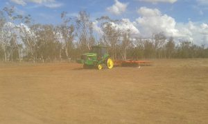 Tilling the ground prior to planting