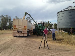 Filming the loading of the wheat