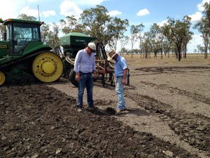 Quentin and Rob check soil moisture prior to planting