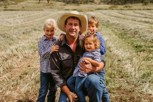 Jules with his children in the field.