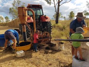 Helping Dad & Granpa in the field