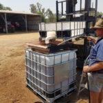 Stephen preps tanks of bio fertiliser by adding water