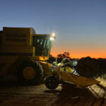 Finishing the harvest at sunset